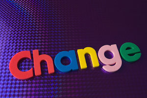 colorful change word on blue neon background